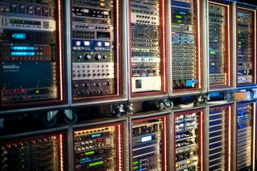 A series of patch bays full of preamp and other audio equipment