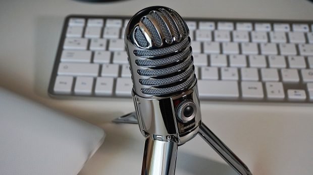 A desktop microphone for use in a podcast.