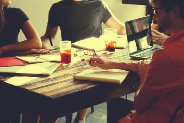 people meeting at a table for collaboration