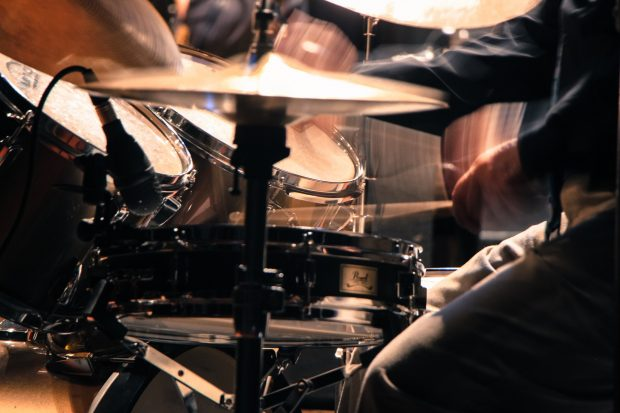 A drum kit being played with heavy technique, similar to what can be achieved using parallel compression.