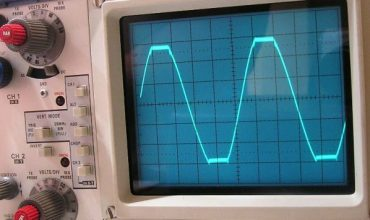 An oscilloscope showing sine wave clipping