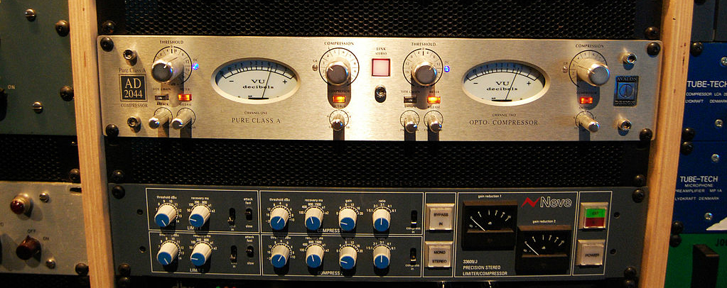 An Avalon AD2044 audio compressor and a Neve 33609/J audio compressor in a rack mount