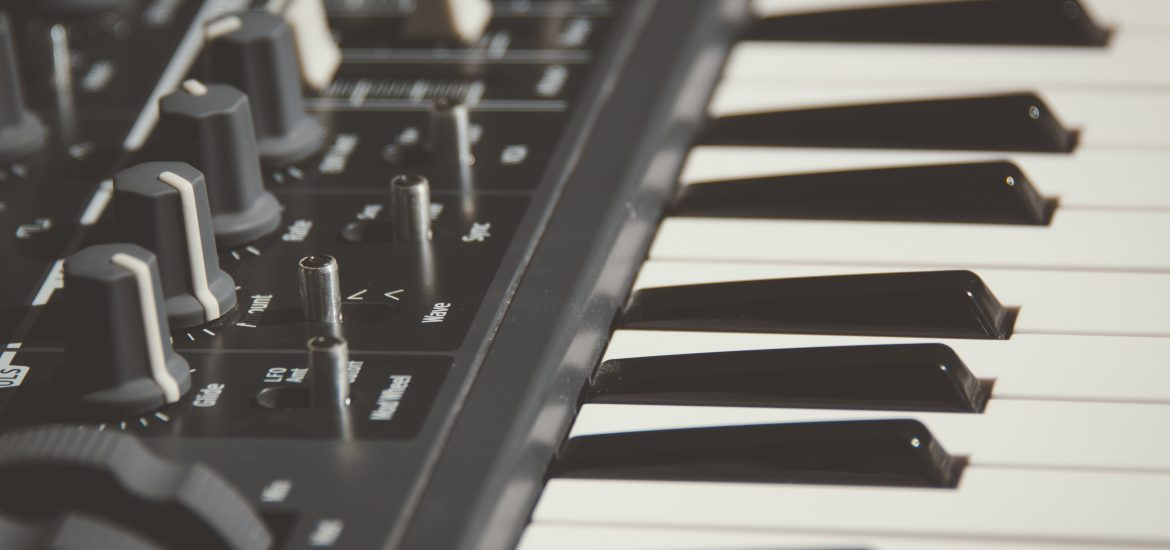 A black and white photo of a midi keyboard with an array of parameters