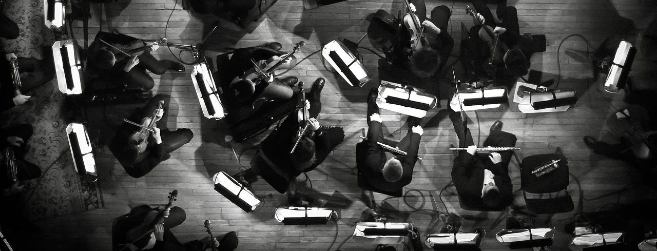 Aerial shot of an orchestra providing a layering composition