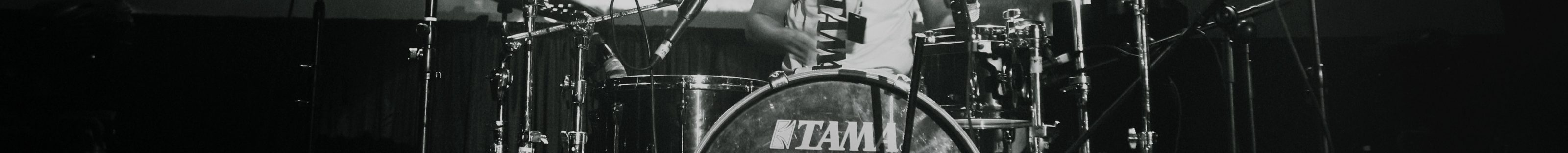 A drummer playing in a venue