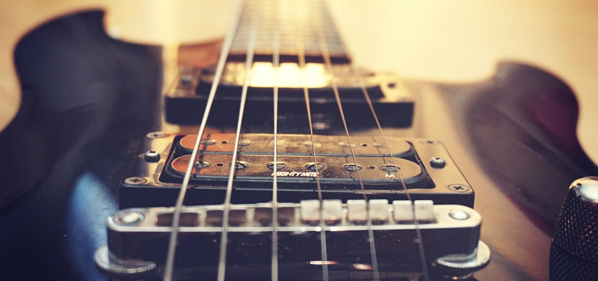 A shot of an electric guitar with hard focus on the pick ups