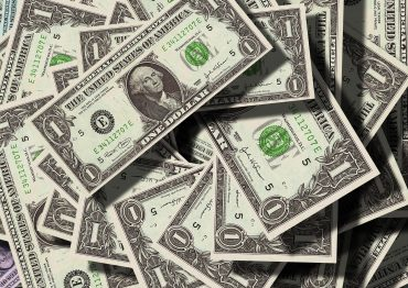 A pile of 1 dollar bills earned from music royalties