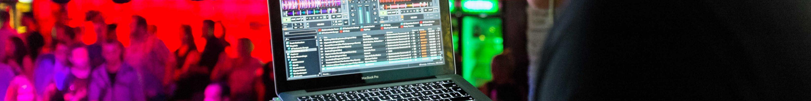 A DJ playing in a nightclub