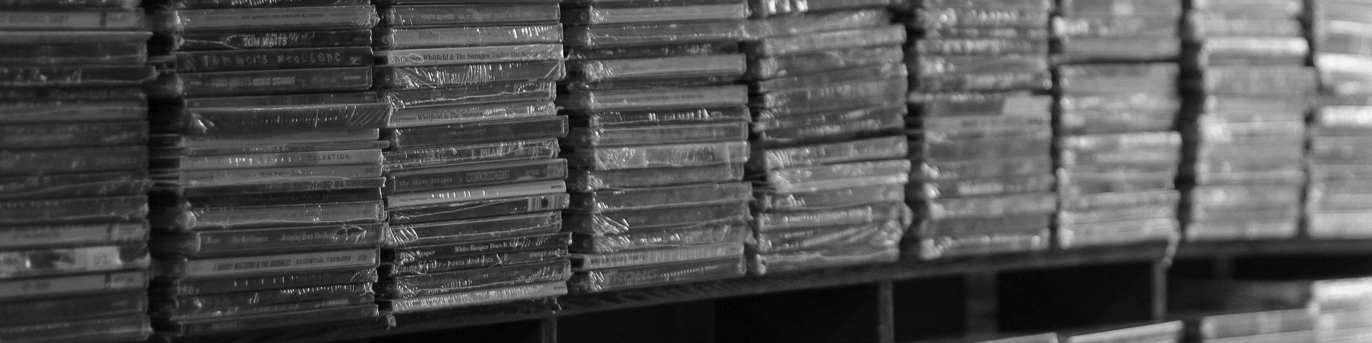 A huge shelf of CDs, ready for distribution
