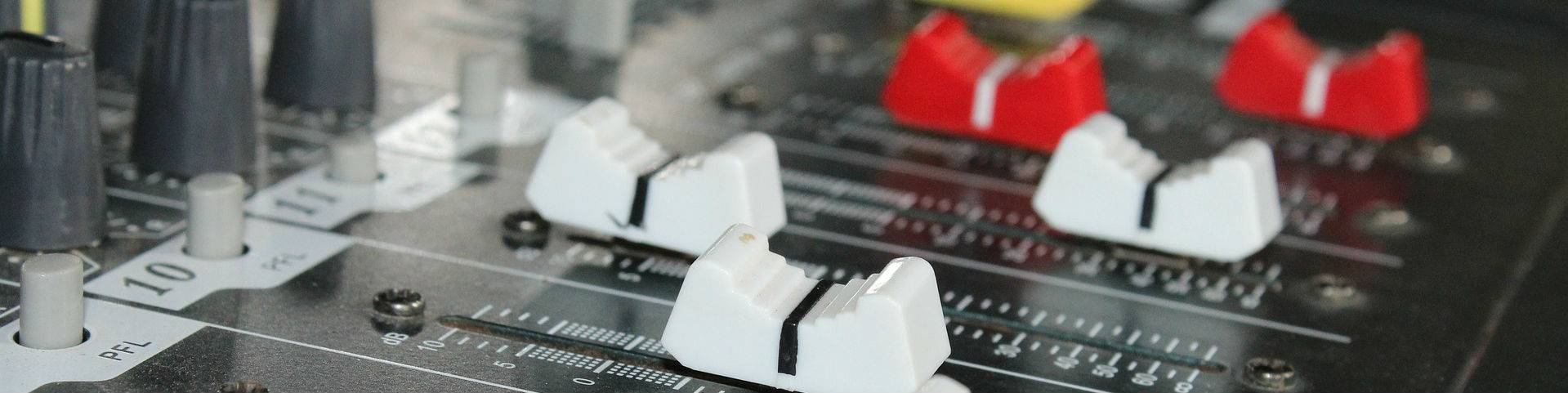 Faders on an analogue desk using for audio summing