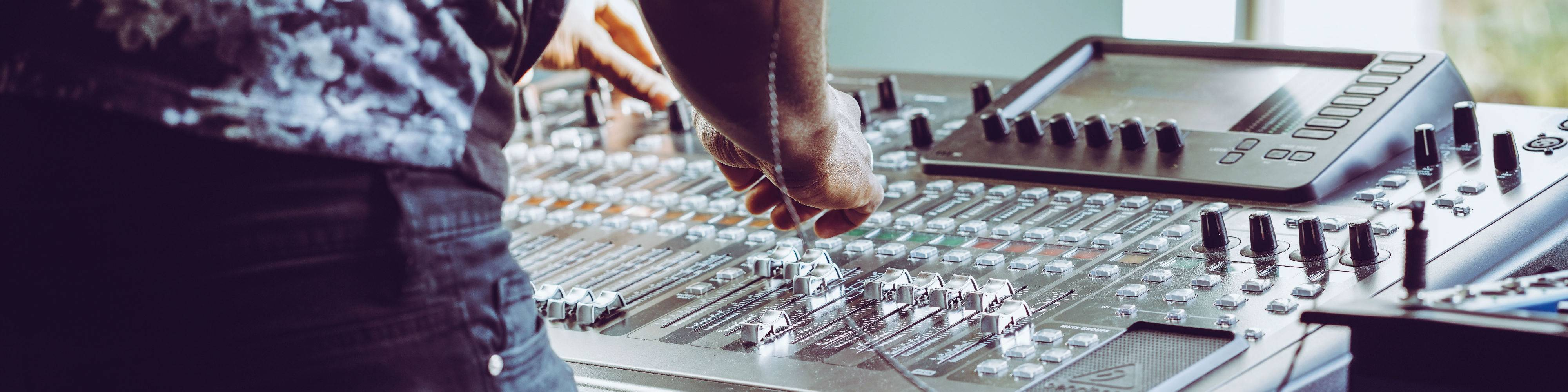 An engineer mixing on a desk